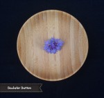 Bachelor Button Flower. Mixed purple flowers, very mild flavor, use individual petals as garnish, many petals on each flower, petals impart no flavor to dish. There are a variety of colors such as blue, pink, white, light purple, and dark purple