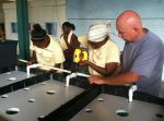 Doug enjoyed teaching the students how to build a system. They loved the power tools!