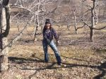 Maria gathering prunings to chip