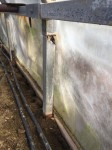 Rusted Greenhouse post and rail