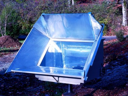 The Broadened Horizons Farm solar cooker using the sun to cook our food.