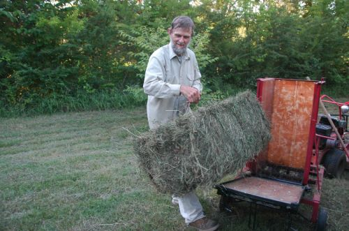 "Dropping the back gate, farmer leaf removes a tightly packed, standard-sized ""square bale"" of homegrown hay. This implement streamlined our hay-making  process by a factor of 10."