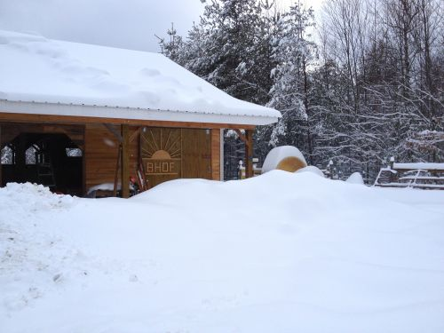A 24 inch snow event in February 2014 buried the northside parking area of the barnyard. The tractor stall is behind the sliding door with the sun graphics.