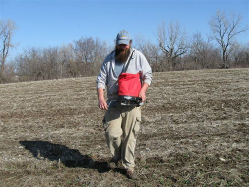 Ben frost-seeding cover crops at the farm