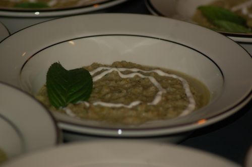 Gazpacho Soup garnished with mint & a swirl of sour cream