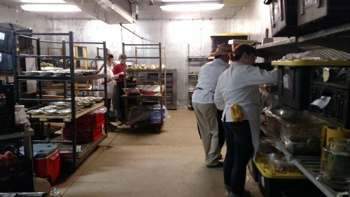 Chefs keeping cool while preparing part of the meal in the cooler