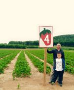 Jarod and Mitch in front of one of our strawberry fields