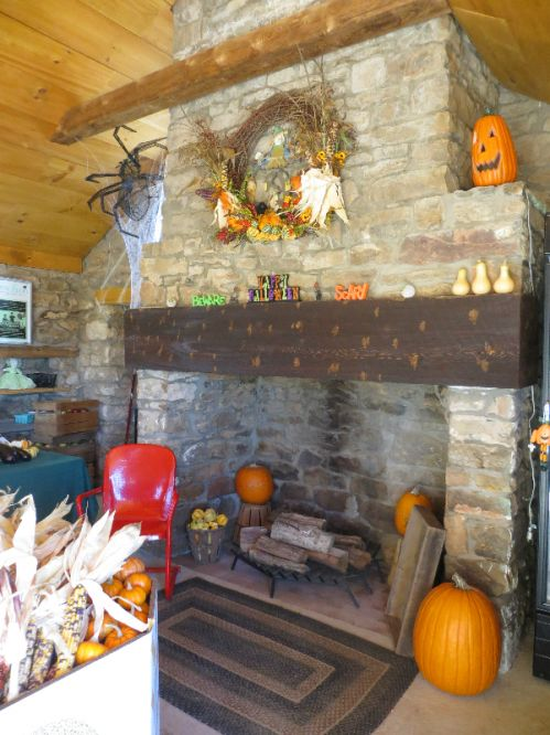 The fireplace located in our store decorated for the fall season.