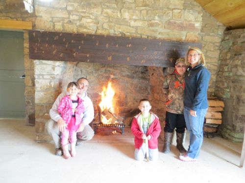 Memorial Day weekend 2013 we started a fire in the fireplace.  We believe the last time it had a fire in it was about 50-75 years ago.  In the picture from left to right is Jarod, Margot, Mitch, Mason, and Robyn Schreiber.  The building we are all standing in was once a house!