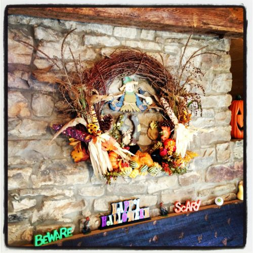 Autumn decorating in our store above the fireplace.