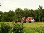 Taking silage bails off the field