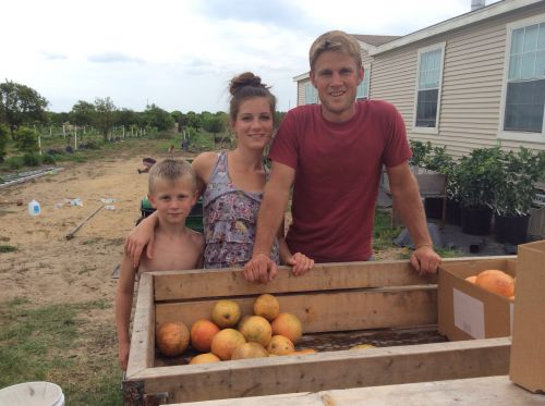 Levi, Aubrey and Jeremiah washing citrus