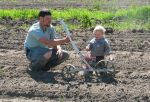 Jacob and Forrest seeding beets