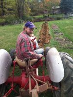 farmer Ry on our 1939 tractor
