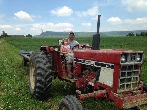Sean and Ginger pulling the wagon with a tractor that used to belong to my Grandparents.