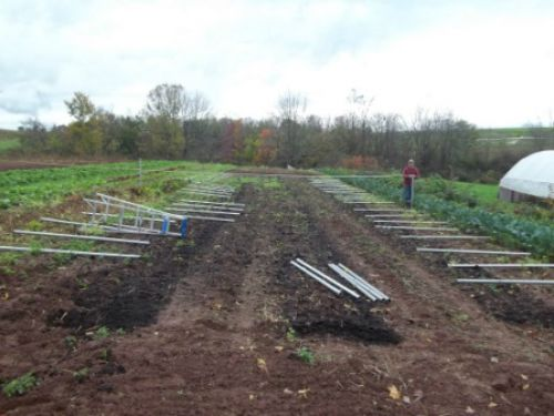 Laying out ground stakes for high tunnel