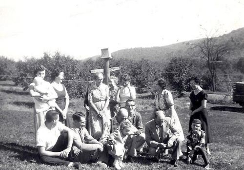 Preparing for a Family Photo, orchard in the background