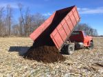 Spreading compost on the farm