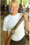 Master gunsmith, Carl Hannekin displays a gun that was being made on site