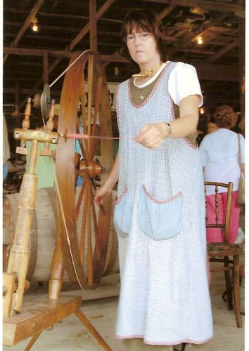 Cathy Perry using a rare spinning wheel