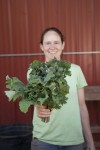 Emily holds a bunch of kale. Photo credit: Sarah Toor
