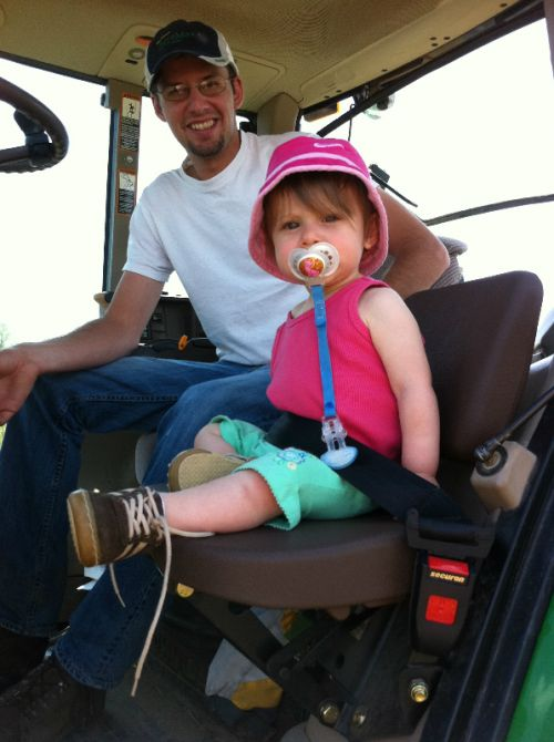 Ready to help daddy in the tractor
