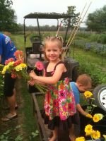 Avery putting flowers in buckets