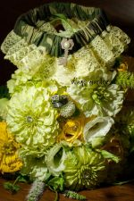 yellow, white and green zinnias, lisianthus, roses