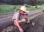 Col and Yeshe planting onions