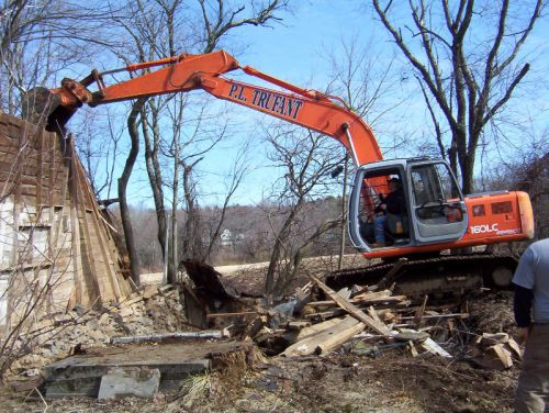 P.L. Trufant & Sons takes down barn.