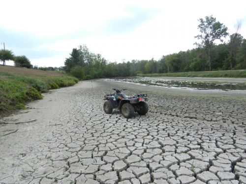 dry pond with 4wheeler