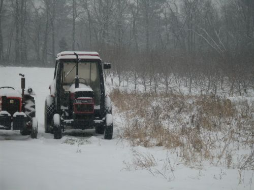 The tractors get caught out in the elements