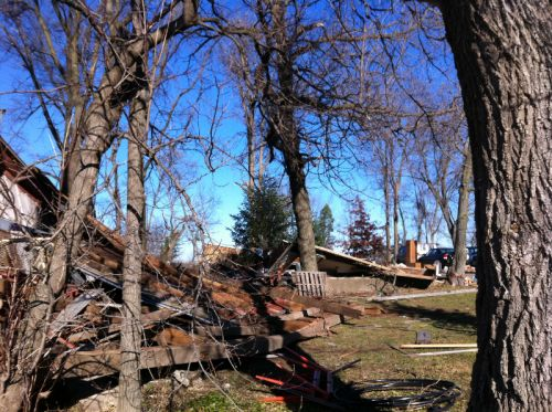 Path of the tornado from the barn straight throught he outbuildings