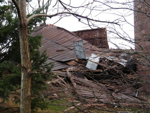 Side view of barn with roof collapsed