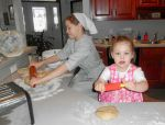 The girls making bread for Daddy.
