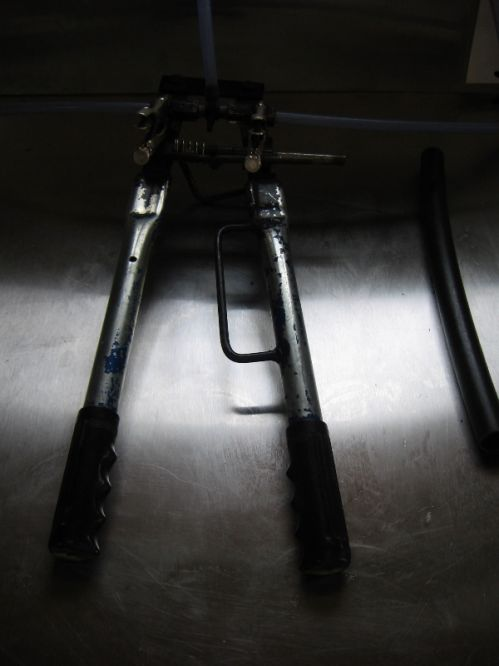 Two-Handed Tool which is used to install the drops on the lateral tees.