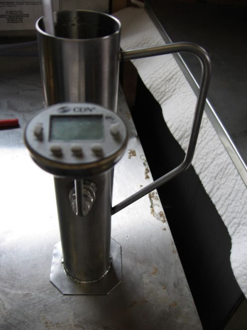 Hydrometer Cup used to check Density.  Hydrometers measure density and they are very sensitive to temperature which is why there's a thermometer in the cup.
