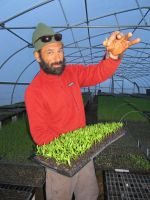 Chris with seedlings.