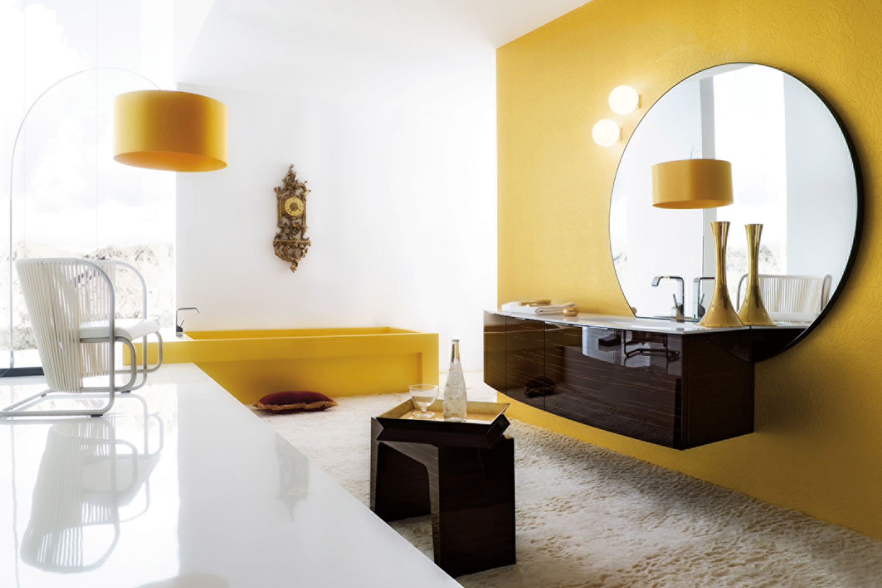 Contemporary master bath features yellow accent wall, semi-custom wall-mounted high gloss laminate floating vanity with white counter and undermount sink, yellow-painted surround for the soaking tub and low pile carpet throughout. Design by Jeff Eakley of Bilotta Kitchens.
