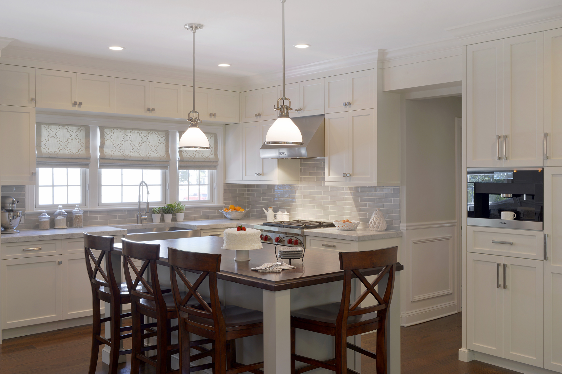L Shaped Transitional Kitchen Features Island With Seating And Fully  Custom, Double Tiered
