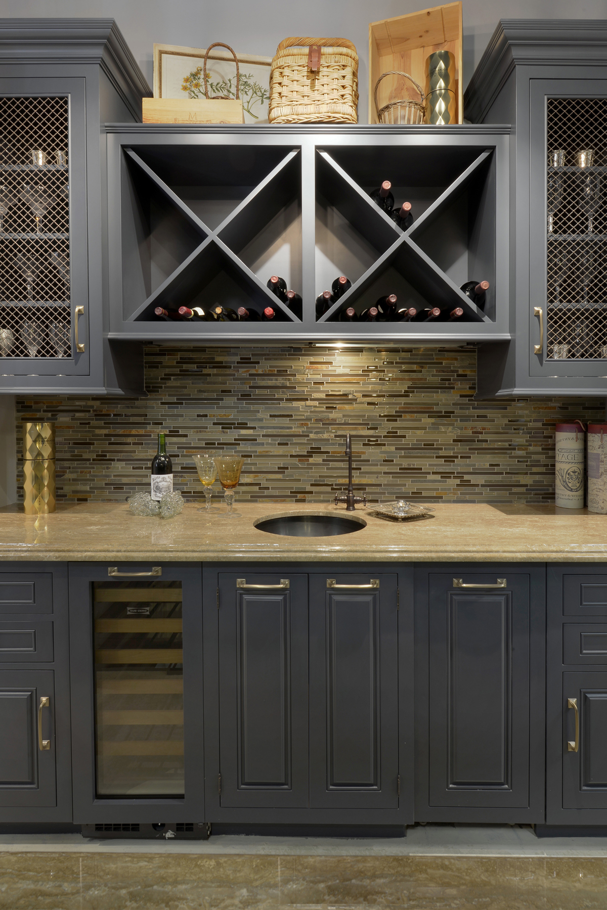 Traditional kitchen with fully custom Wood-Mode cabinets. Kitchen features blue painted wine racks, and cabinets with both glass fronts and wire mesh cabinet door inserts accented by brass hardware. Designed by Paula Greer, CKD of Bilotta Kitchens.