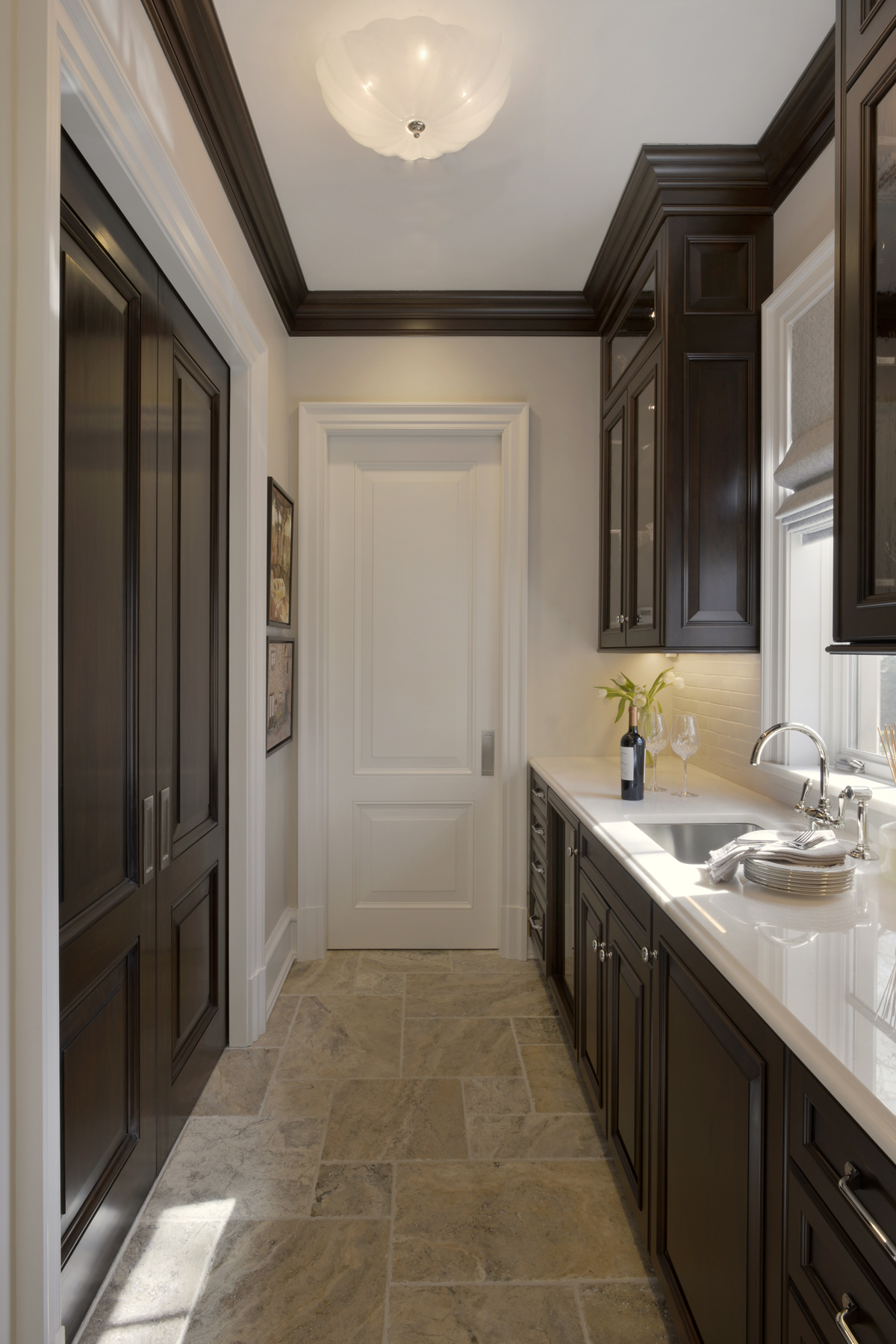 Butler's pantry with cherry double-tiered fully custom cabinets and white countertop. Raised panel Rutt Handcrafted cabinets. Designed by Tom Vecchio of Bilotta Kitchens.