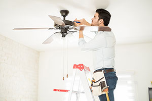Electrician fixing Ceiling Fan