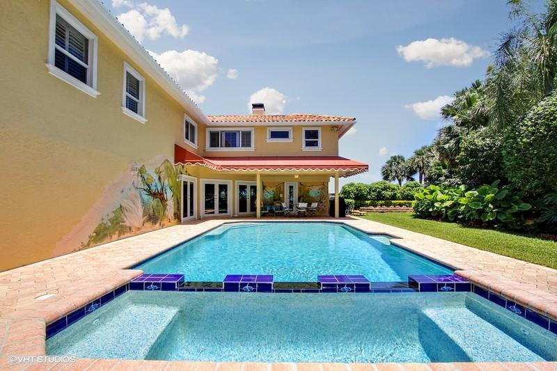 HOME SALES. Waterfront pool home, properties for sale, West Palm Beach house with pool.