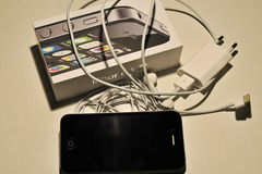 Selling: iPhone 4S 8GB black with 3 cases