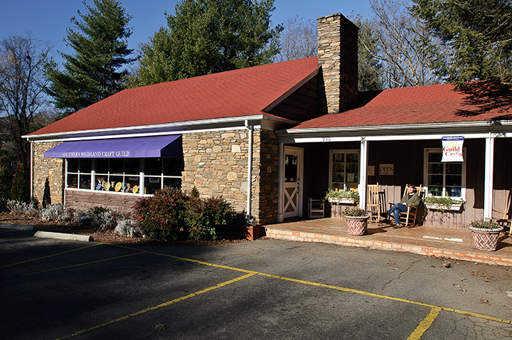 front view of guild crafts on tunnel road with purple awning and flower, nc craft gallery, asheville nc