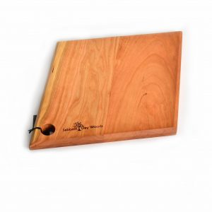 Diamond shaped wooden cutting board with hole to hang it with