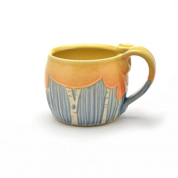 fall tree mug, mug by meghan bernard, orange tree and blue background with handle