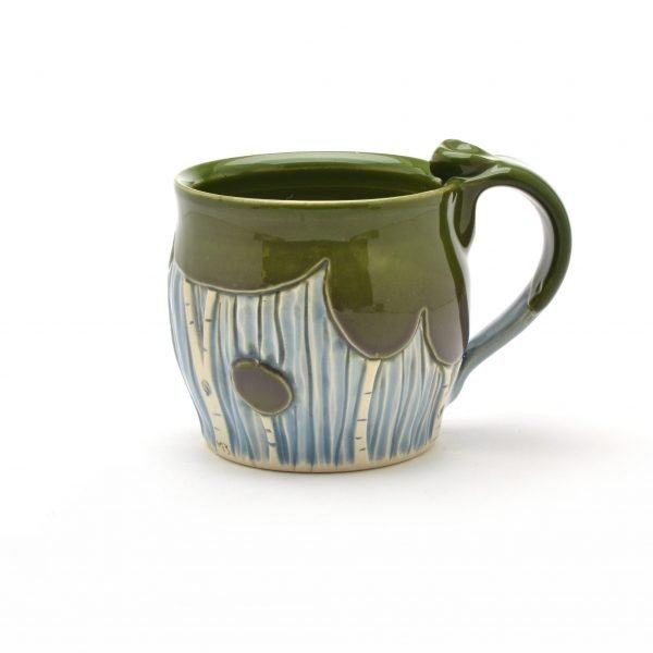 low round wheel thrown mug with dark green trees and blue background, nc clay, nc potter, asheville crafts