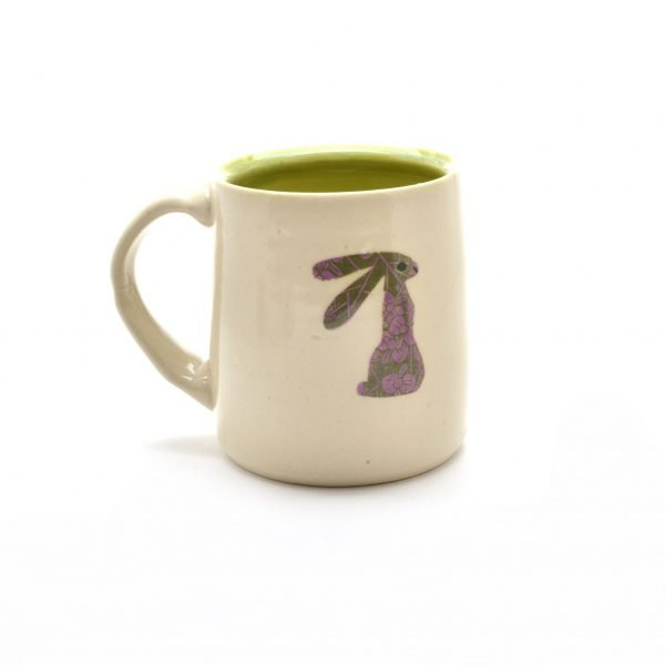 wheel thrown handmade mug with rabbit decoration,